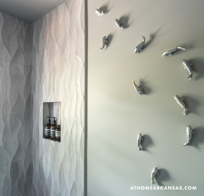 Sculptural fish details in this modern bathroom