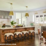 The formerly dark and cramped kitchen is now a light—yet still homey—hub. A massive, centrally located island offers space for food preparation and eating snacks, while a new, round dining table is a slightly more formal place for family meals. The rustic wood and leather juxtaposes with the polished quartzite countertops and brass fixtures for a distinctive blend of styles. At Home in Arkansas | November 2015