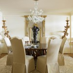 In the dining room, the neutral palette gives center stage to the real show stoppers: an antique Murano glass chandelier, a sleek Rose Tarlow dining table, and two Louis XIV sconces with the original gilt still intact. At Home in Arkansas | November 2015