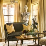 A bronze statue on the coffee table and an oversided urn in the corner add sculptural interest. At Home in Arkansas | November 2015