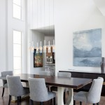 The dining table, which was custom-made by Tommy Farrell of North Little Rock's Tommy Farrell Custom Furniture, was inspired by a piece the Vurals had seen and admired through the years. Its contemporary appeal makes it the standout piece in the dining room. | Modern Thinking | At Home in Arkansas | Jan/Feb 2016
