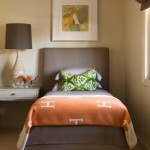An Hermès throw is draped at the foot of the bed in the guest bedroom. Hermès' iconic orange is a signature color that the luxury brand first adopted during the mid-century era. | Mad for Mod | At Home in Arkansas | Jan/Feb 2016