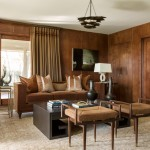 Risinger updated the wood-paneled walls of the den and added a copper reveal for a glamorous touch; along with the caramel and tan tones of the furnishings, they create a moody, masculine intensity. | Mad for Mod | At Home in Arkansas | Jan/Feb 2016