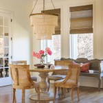 """The breakfast nook just off the kitchen, which features a bank of windows and a view of the neighborhood pond, is Montgomery's favorite spot in the house. """"I love to sit here and have coffee to start the day, and look out the windows at the view."""" 