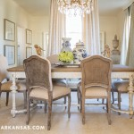 One wall of the dining room is covered with floor-to-ceiling mirrors to elongate the space. Davis spotted the table at Round Top Antiques Fair in Texas, and the chairs are reproductions.  | A Happy Happenstance | At Home in Arkansas | April 2016