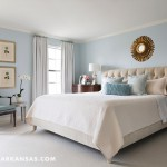 The master bedroom is enveloped in a calming shade of blue that flows with the rest of the home's palette.  | Cottage Charmer | At Home in Arkansas | April 2016