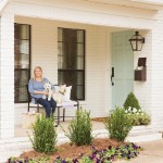 Olivia Ramsey and her westies, Junebug and Mac, greet guests at the home's front door.  | Cottage Charmer | At Home in Arkansas | April 2016