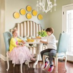 Millie and Peyton Brown grab a snack—with a smile!—at the banquette in their West Little Rock home's kitchen. | Fashionable & Functional | At Home in Arkansas | May 2016