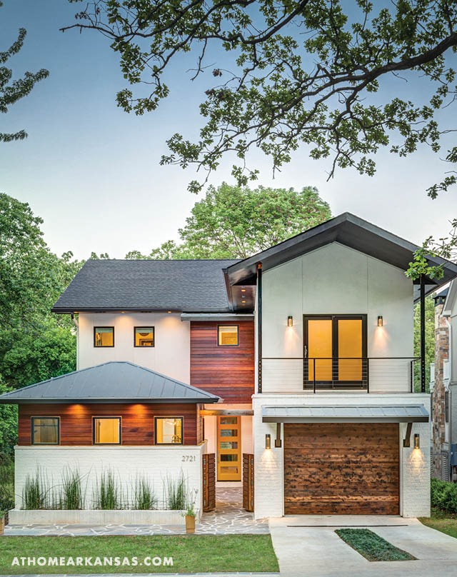 An assortment of Chris's favorite materials—wood, concrete, and stone—lend texture and warmth to the home's contemporary exterior. | Sense of Place | At Home in Arkansas | June 2016