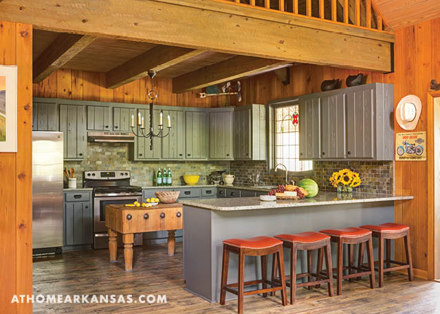In the kitchen, pecky cypress cabinets were given an update with a ...