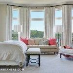 Brun sought a hotel-like serenity in the master bedroom. The sofa is by Bernhardt, and the armchairs brought in form the great room have new life in the master bedroom. | Rooms With A View | At Home in Arkansas | July 2016