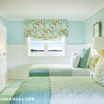 In the home's lower level bunkroom, which often hosts grandchildren, simple pale blue quilts dress the beds. | Rooms With A View | At Home in Arkansas | July 2016