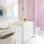 The girl's bath features a paisley wallpaper by TKTK and custom marble flooring laid in a herringbone pattern. | Home at Last | At Home in Arkansas | August 2016
