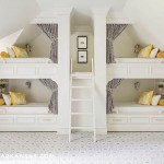 Walsh designed custom bunks -- one for each of the family's four children -- that are accessible to each other via cut-outs in the wall. Each features a shelf for personal belongings and a nautical-inspired sconce by Circa Lighting. The graphic carpet is by David Hicks. | Home at Last | At Home in Arkansas | August 2016