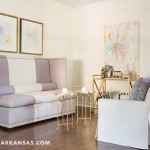 """This seating area is ideal for """"sitting and chatting the night away"""" on the chic, color blocked banquette Molly had recovered. Two watercolors from local artist Ashley Saer hang above it, with a bar cart nearby to play the role of stylish bartender. 