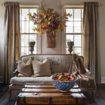 A trunk doubles as a coffee table, while fall décor and a rural landscape painting add a hint of color to the room.  | Best in Show | At Home in Arkansas | November 2016