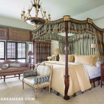 A soft duck egg green envelops the master bedroom. The bed is a reproduction by Baker. Light and privacy are controlled by shutters installed on the outside of the windows. | Historical Influence | At Home in Arkansas | November 2016