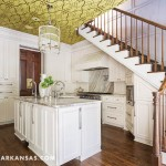 The kitchen's ceiling is papered in a graphic print by Nina Campbell. The refrigerator, freezer, warming drawers, and dishwashers are all concealed behind cabinetry panels. The hardware is silver gilt, and task lighting is conspicuously hidden in the molding. | Historical Influence | At Home in Arkansas | November 2016