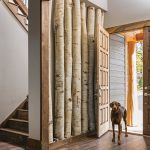 Real aspen trees lining the entryway remind the homeowners of Colorado.