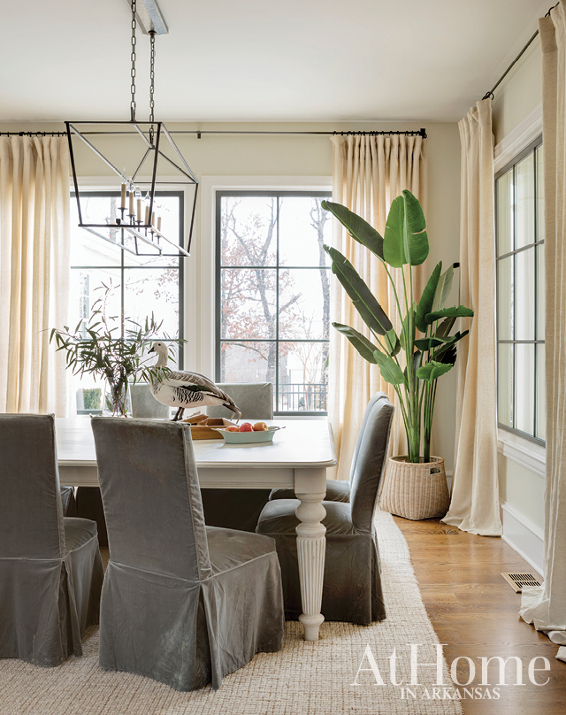 To make the dining room sensible for everyday use, Jill employed chairs with slipcovers, which can be thrown in the wash and cleaned again and again.