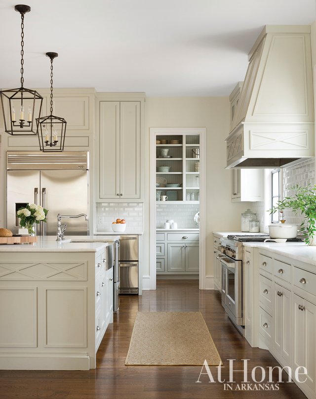 "Efficiency and storage were two must-haves in the kitchen design. ""It has a good work triangle and doesn't bottleneck when multiple people are in there,"" Jill says of the flow. A large walk-in pantry (located behind the refrigerator) solved for storage, while pocket doors keep its contents, everything from dry goods to small appliances, neatly concealed."