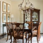 Krista incorporated the couple's existing table, chairs, and china cabinet, which holds numerous treasures collected through the years, into the design by pairing it with a light blue console table and draperies.