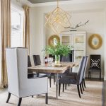In the dining room, the natural vibe of the live-edge table paired with upholstered chairs and mixed metals (including a silver-and-gold cork ceiling) hint at the unexpected design pairings found throughout the rest of the home.