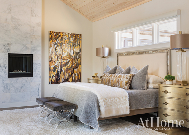 The luxe-cabin feel established in the communal rooms extends to the master suite, where Henry aimed for beautiful yet not too feminine, cozy yet elevated. The tall, paneled ceiling is coated in a light wash of the wall color, which exaggerates its height and adds to the airiness of the room.