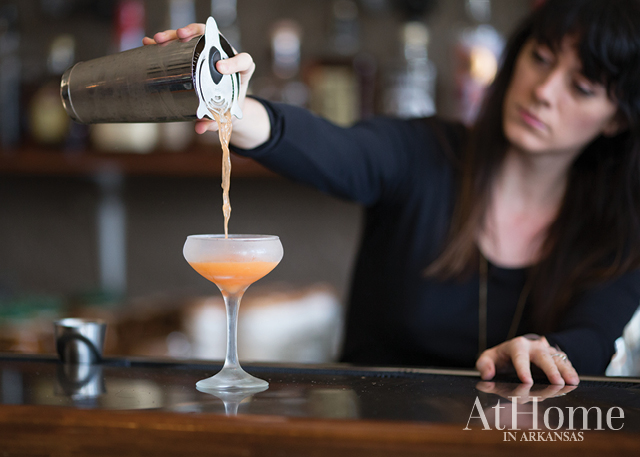 Amy Kelley Bell pours a cocktail at South on Main restaurant and bar in Little Rock, Arkansas