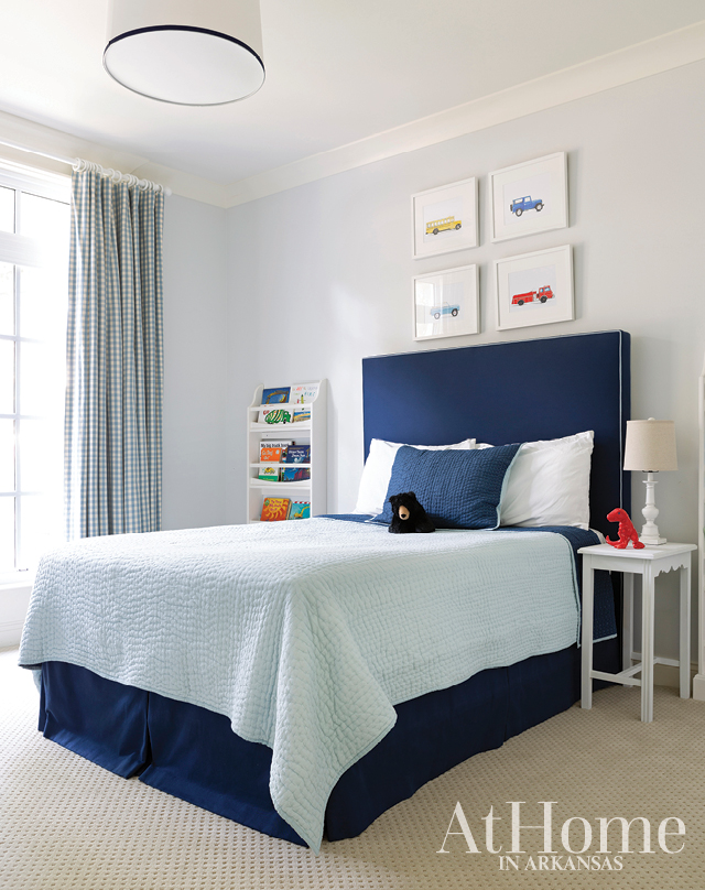 Little boy's room with navy and trucks theme