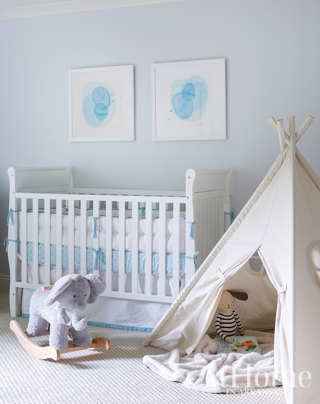 While the nursery's crib and changing table are repurposed from big sister and brother's nurseries, the family's newest addition had his room personalized with new linens, art by Ashley Saer, and a teepee perfect for tummy time and hide-and-seek with siblings.