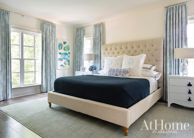 An abstract painting by Ashley Saer adheres to the palette while bringing a contemporary flair to the master bedroom, a restful retreat for two busy parents.
