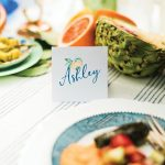 Placecards with each guest's name and a nod to the lemon theme make attendees feel special.